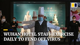 Hotel staff in Wuhan exercise daily to stave off coronavirus infection