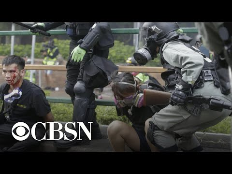 Hong Kong police clash with protesters as university is under siege