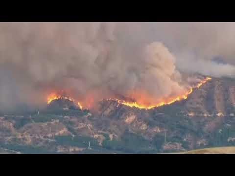 Ash falls like snow as celebrities flee California community
