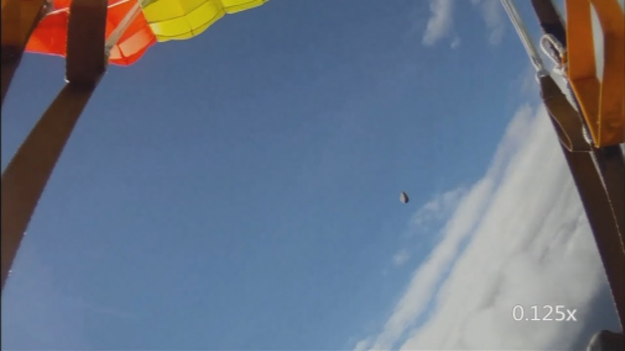 'Meteorite' filmed by skydiver: Footage of hurtling black rock filmed over Norway
