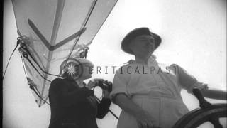 J-class yacht Ranger wins America's Cup by defeating Endeavour II of Britain by 4...HD Stock Footage