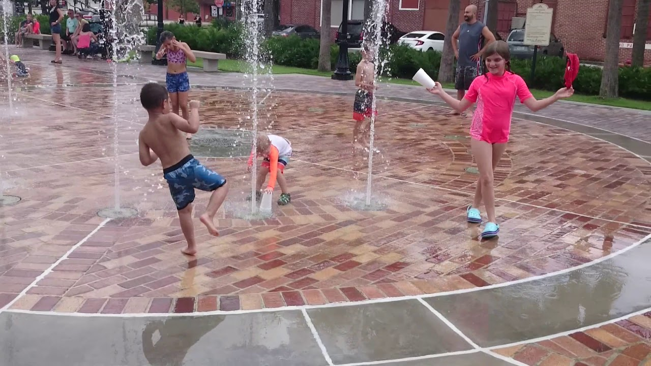 emerson and olivia fun with cups at winter garden splash pad youtube