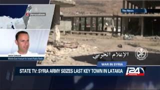 State TV: Syria army seizes last key town in Latakia