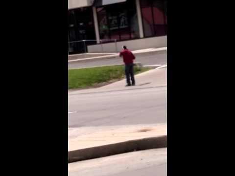 Man dancing on main street in Dayton ohio