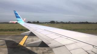 Garuda Indonesia landing and taxi at Kuala Namu Medan Airport in Deli Serdang