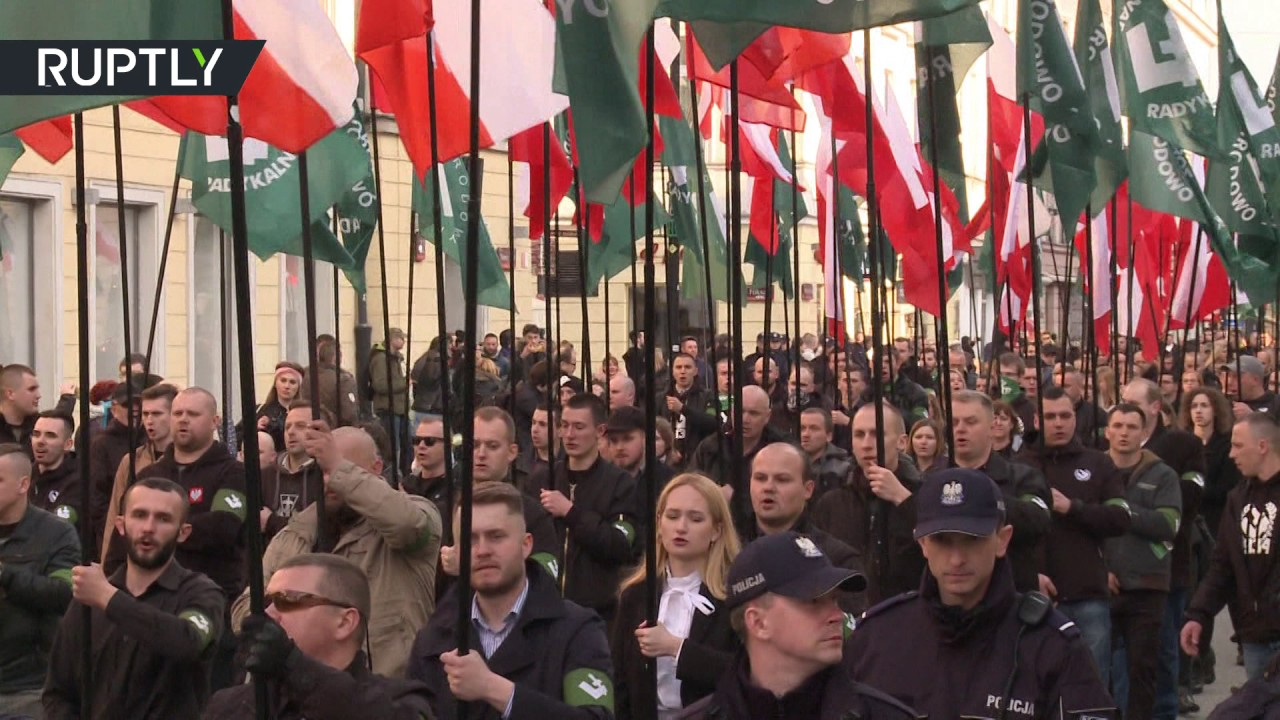 'Death to enemies of homeland': Nationalists march through Warsaw, heckled by counter-protesters