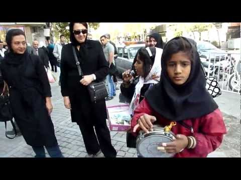 Iran-Young girl singing in front of Jomeh Bazar-Tehran-2011