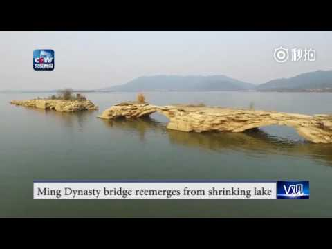 A bridge from Ming Dynasty (1368-1644) reemerges from Xiannu Lake after water levels drop