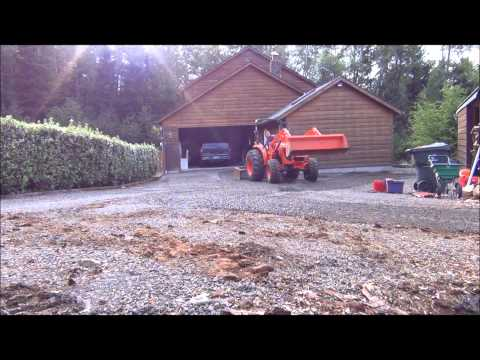 Using my Kubota MX5100HST to spread some gravel in a driveway