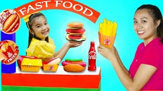 Hana Pretend Play Selling Fast Food Toys at her Cardboard Restaurant Food Cart