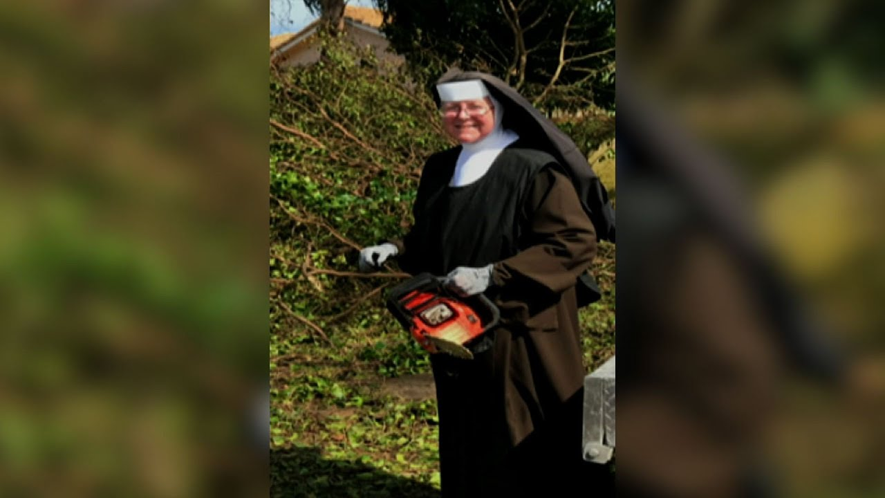 fla-nun-chainsaw-in-hand-cleans-up-after-irma