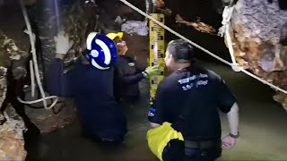 Rescuers try to drain flooded Thailand cave, find other entrances