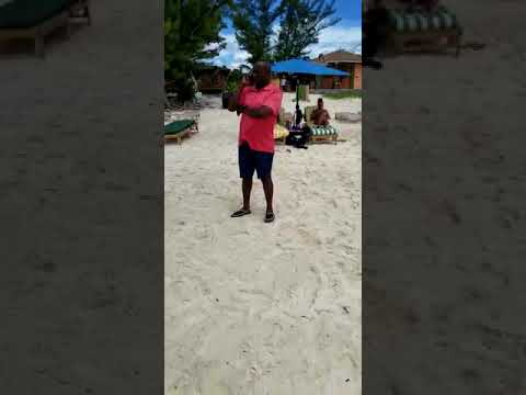 Former MP Davd Wallace Selling Coconuts On The Beach In Grand Bahama Attempts To Run The Small Man
