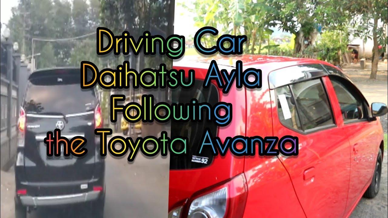 Driving Car Daihatsu Ayla Following the Toyota Avanza