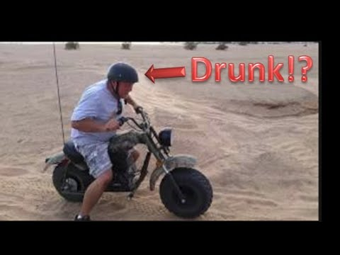 Drunk Guy Riding Mini-Bike in Sand Dunes