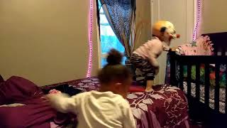 Little girl scares her cousin with  scary clown mask