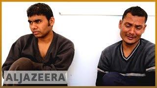 Desperate journeys: Migrants repatriated after 3 weeks stranded off Tunisia