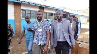 Imran Okoth casts his vote as Mariga gives moral support