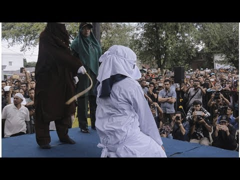 Indonesia's Aceh canes couples for public shows of affection