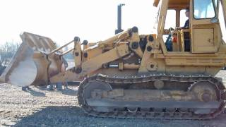 Unloading a Caterpillar Track Loader off Lowboy