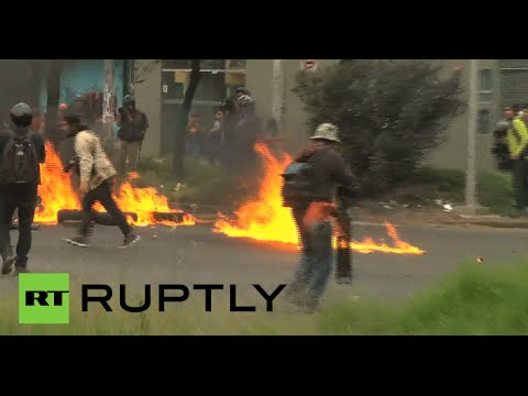 Mexico on brink: Protesters clash with riot police over student massacre