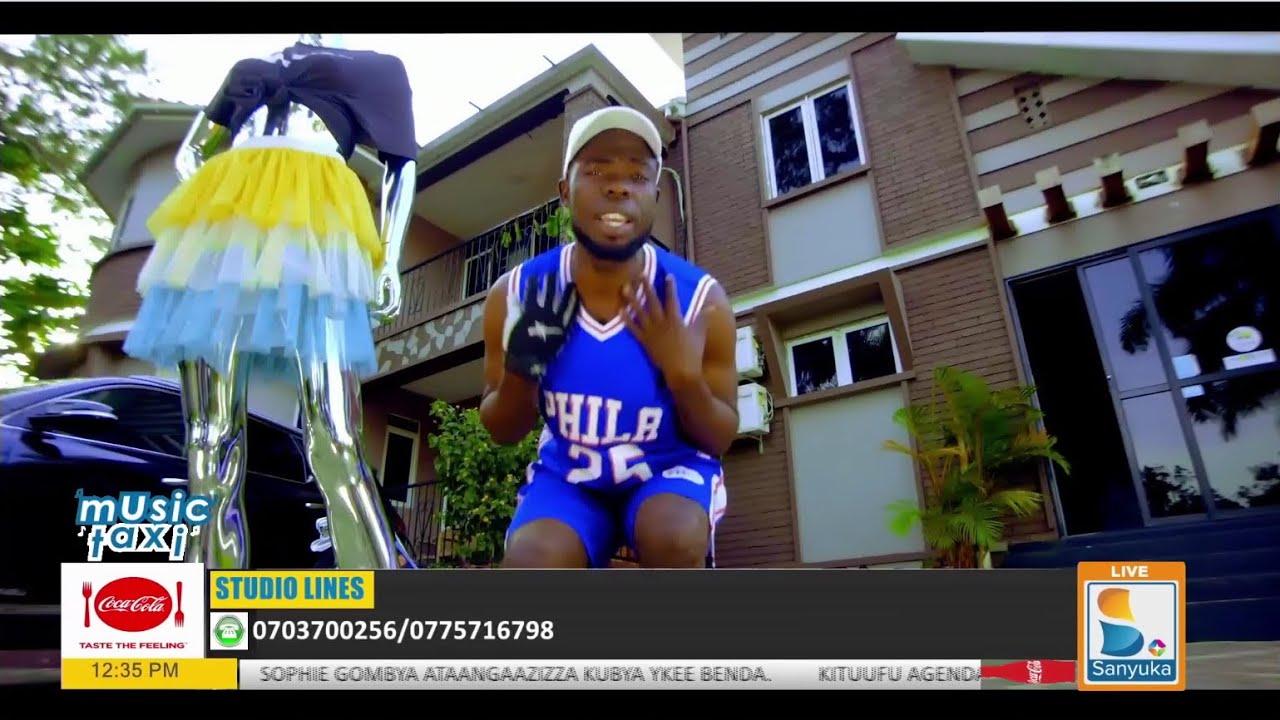Download Enyambala ya Chris Evans mu video ye ne John Blaq yeewunyisa----Mukunja| Music Taxi