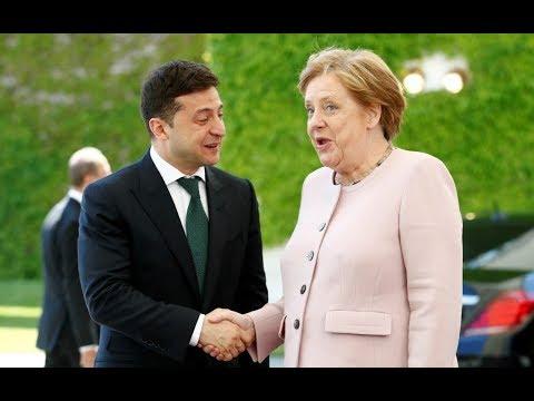 Merkel violently shakes