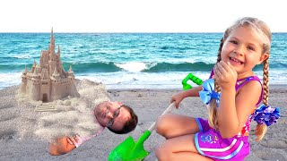 Diana and Roma have fun on the Beach with Daddy
