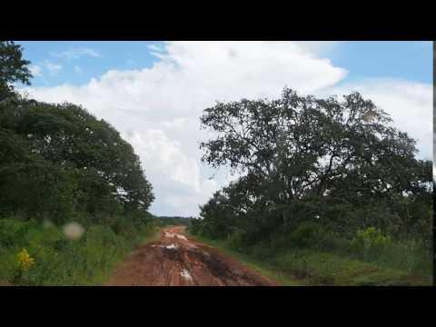 P2233017   Modderrijden onderweg naar Mpanda