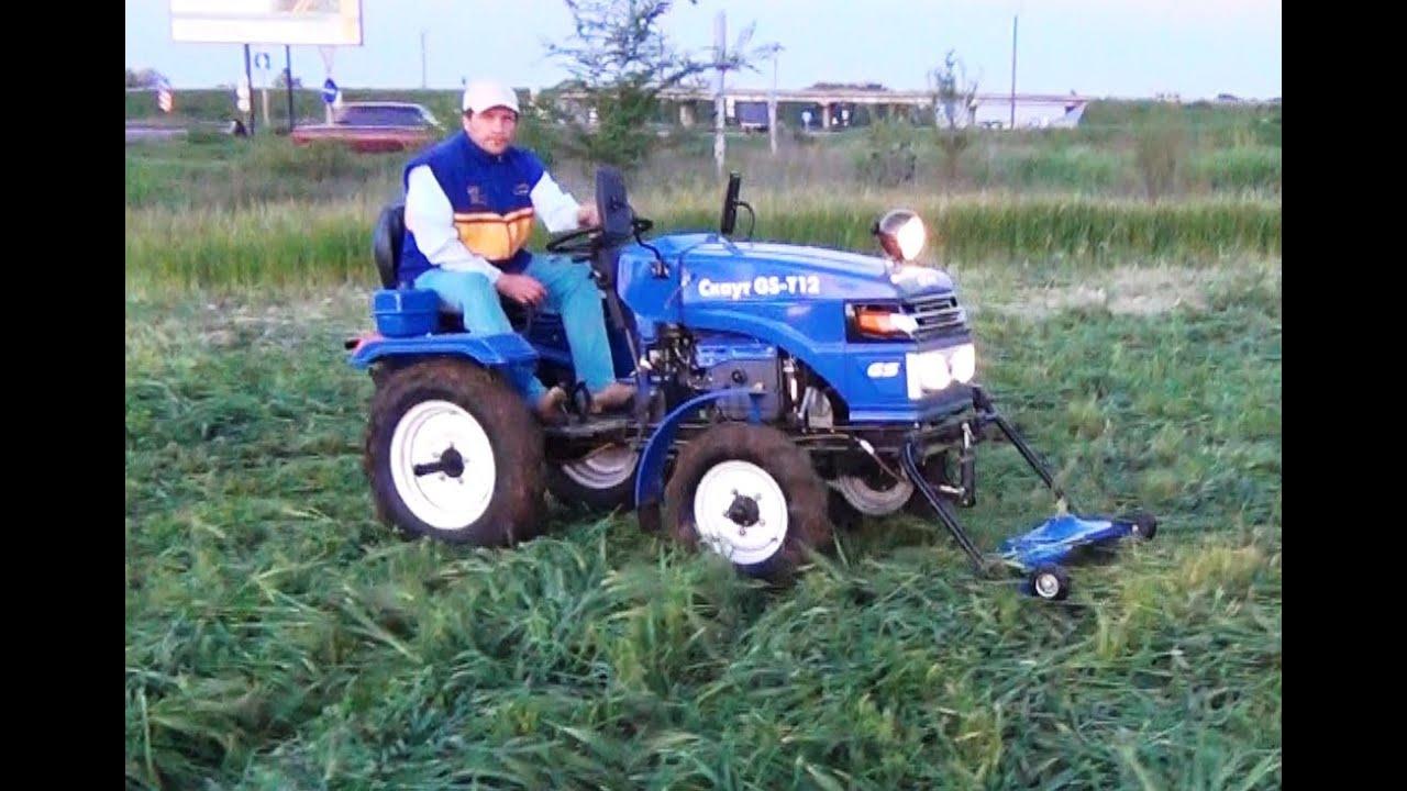 Работа трактора Скаут с роторной косилкой