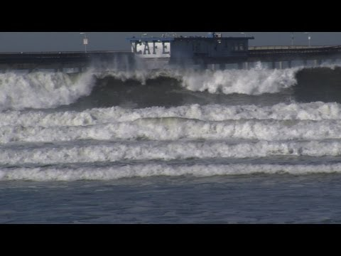 Huge 15-Foot Waves Rock Ocean Beach Surfers and Spectators