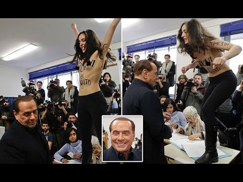 Topless activist jumps in front of Silvio Berlusconi as he votes