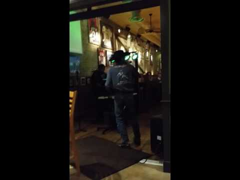 Cowboy singing karaoke