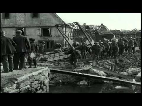 US 7th Army soldiers advance and build a bridge across Seltzbach river in Alsace,...HD Stock Footage