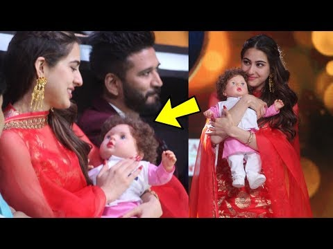 Sara Ali Khan looks so cute playing with her brother Taimur Ali Khan's doll