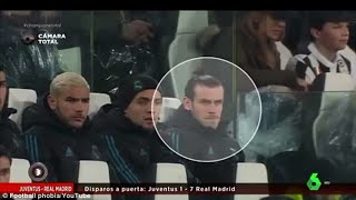 Gareth Bale looks glum on the bench while Real Madrid coaches and subs celebrate Cristiano