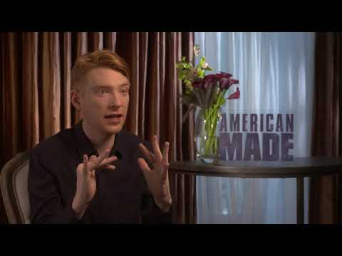 Domhnall Gleeson of AMERICAN MADE complete with falling props