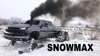 Lifted Duramax on SKIS and 36 WIDES eats through snowdrifts