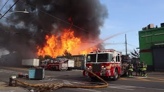 FIRE IN THE BRONX !! FDNY battles a BLAZING 5th Alarm FIRE in a pallet yard. Huge flames melt cars !