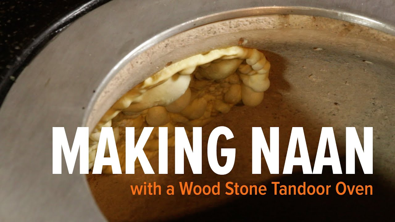 & Making Naan Bread in a Tandoor Oven -- Wood Stone Tandoor - YouTube