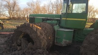 John Deere 8850 Tractor Stuck in Muddy Field in North Dakota Pulled Out by Another 8850