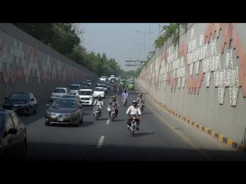 Canal Road Lahore early morning traffic through Punjab University