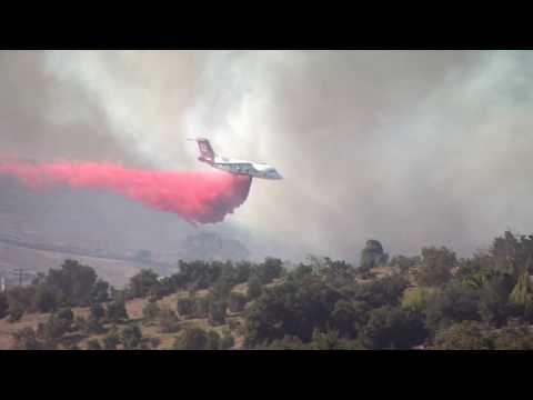 Fast-Moving Winds Drive Wildfires In North County San Diego
