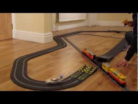 Slot car jump through a moving Lego train