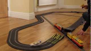 Slot car jump through a moving Lego train