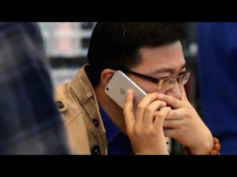 China rules against Apple over iPhone patent claim