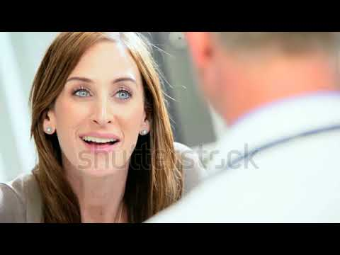 young female business consultant meeting with male caucasian doctor in practice rooms