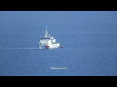 Turkish Coast Guard TCSG 701 Dost intercept immigrants rubber boat.
