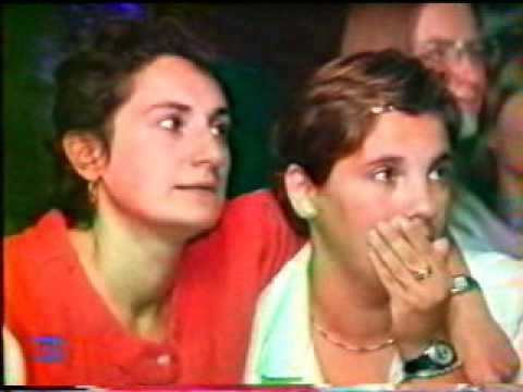 Coaches and fans watching Eva Serrano on 2000 OG
