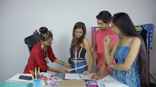 A creative team of students and a teacher learning body measurements together